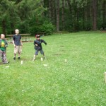 Some OR kids playing Kubb at the ORV Summer Moot 2009